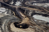 The Syncrude Canada Ltd mine is seen in this aerial photograph taken above the Athabasca Oil Sands near Fort McMurray Alberta Canada on Wednesday...