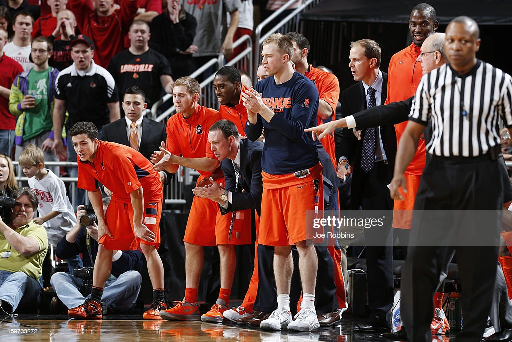 The Syracuse Orange bench celebrates during the game against the Louisville Cardinals at KFC Yum! Center on January 19, 2013 in Louisville, Kentucky. Syracuse defeated Louisville 70-68.