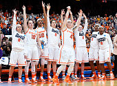 The Syracuse Orange bench reacts to a shot taken by Maggie Morrison of the Syracuse Orange against the Albany Great Danes during the second half in...