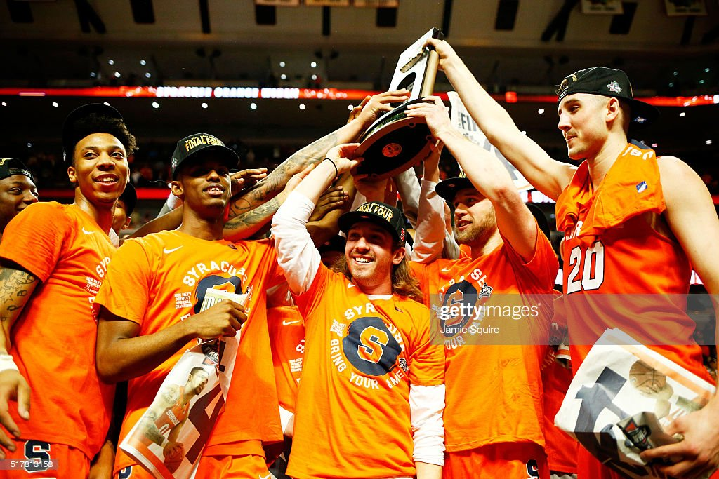 The Syracuse Orange celebrate their 68 to 62 win over the Virginia Cavaliers with teammates during the 2016 NCAA Men's Basketball Tournament Midwest...