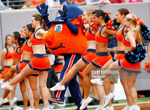 The Syracuse Orange mascot with the cheerleaders during a game against the USC Trojans at MetLife Stadium on September 8 2012 in East Rutherford New...