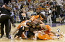 The Syracuse team celebrates at center court after defeating Kansas during the championship game of the NCAA Men's Final Four Tournament on April 7...
