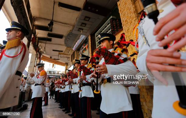 The Syrian Police Music Band performs national songs in Damascus during the a memorial day to remember members of the internal security forces and...