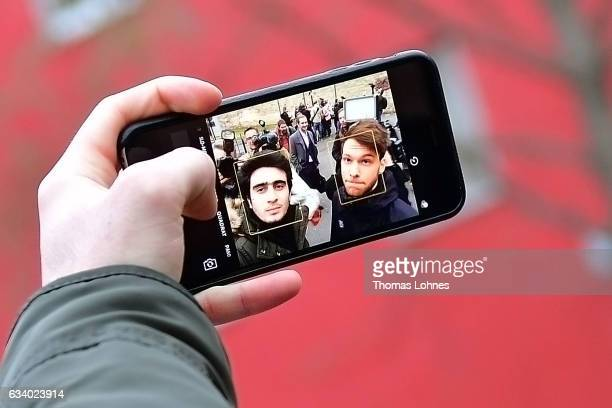 The Syrian refugee Anas Modamani takes a selfi photo with his smartphone after the court session over his lawsuit against Facebook at the Landgericht...