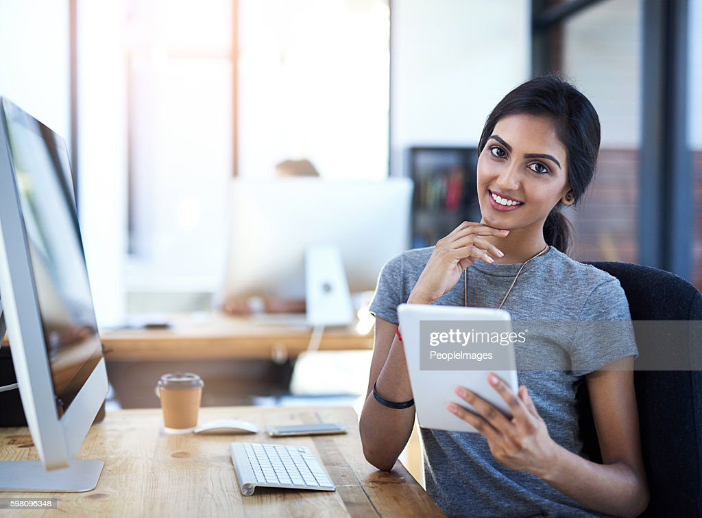 The tablet is one of my favourite business tools : Stock Photo