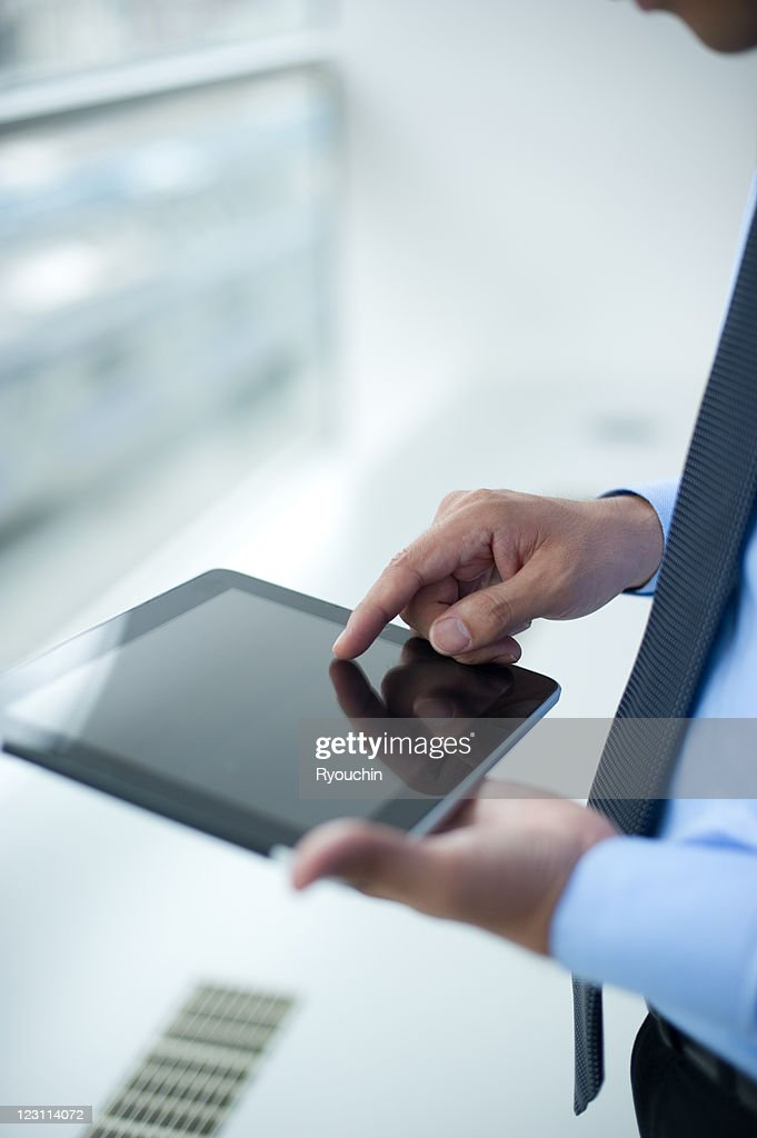 the tablet is used in the office : Stock Photo