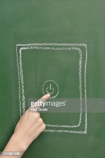 The tablet which is drawn on the blackboard and wo : Stock Photo