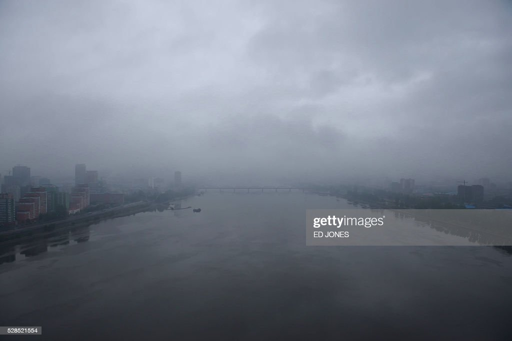 The Taedong River is seen with clouds overhead in Pyongyang on May 6, 2016. North Korea will on May 6 launch its highest-level ruling party meeting in almost 40 years, with delegates set to heap praise on its nuclear arsenal as a 'precious sword' amid fears of a fresh atomic test. / AFP / Ed Jones