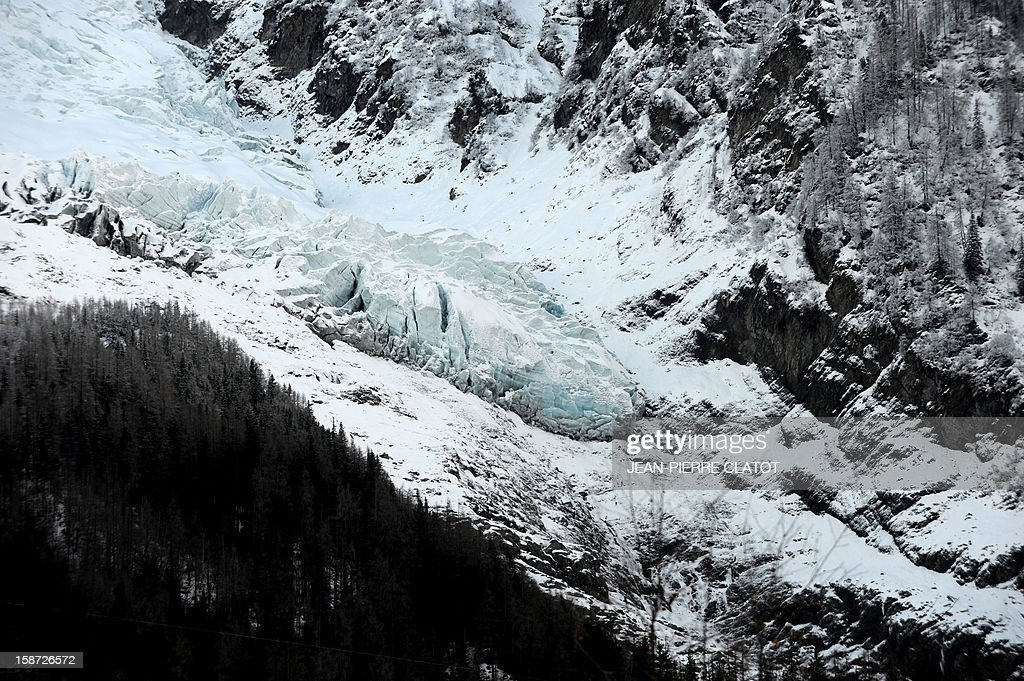 The tail end of the Bossons Glacier in Mont Blanc chain is pictured in the French Alps, on December 26, 2012 in Chamonix. AFP PHOTO / JEAN-PIERRE CLATOT