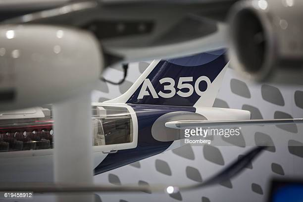 The tail fin of a model Airbus SE A350 XWB sits on display at the China International Aviation Aerospace Exhibition in Zhuhai China on Monday Oct 31...