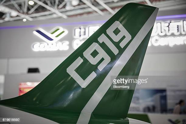 The tail fin of a model of a Commercial Aircraft Corp of China C919 aircraft stands on display at the China International Aviation Aerospace...