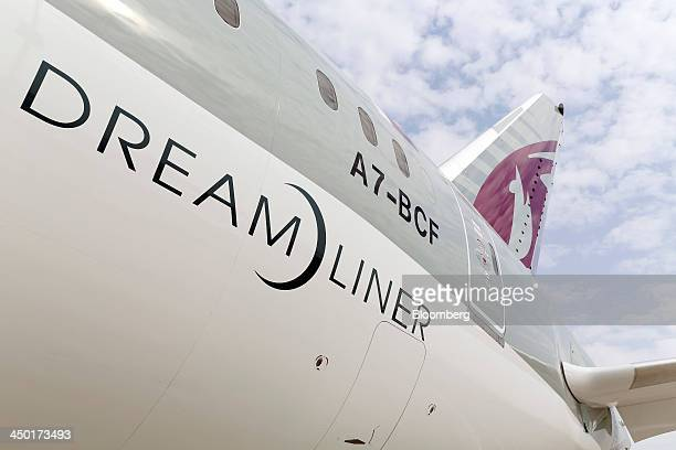 The tail fin section on a Boeing 787 Dreamliner aircraft operated by Qatar Airways Ltd manufactured by Boeing Co is seen on display during the 13th...