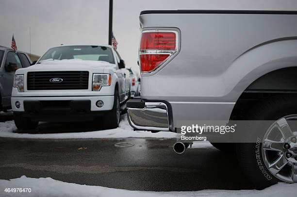 The tail light of a Ford Motor Co F150 truck is seen at the Oxmoor Ford car dealership in Louisville Kentucky US on Wednesday Feb 25 2015 Domestic...