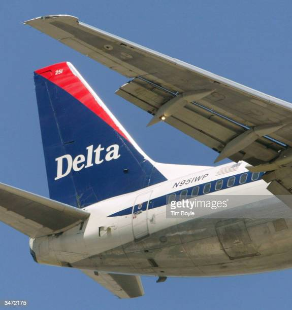 The tail of a Delta Air Lines jet is seen over Bensenville Illinois as it prepares to land April 27 2004 at O'Hare International Airport in Chicago...