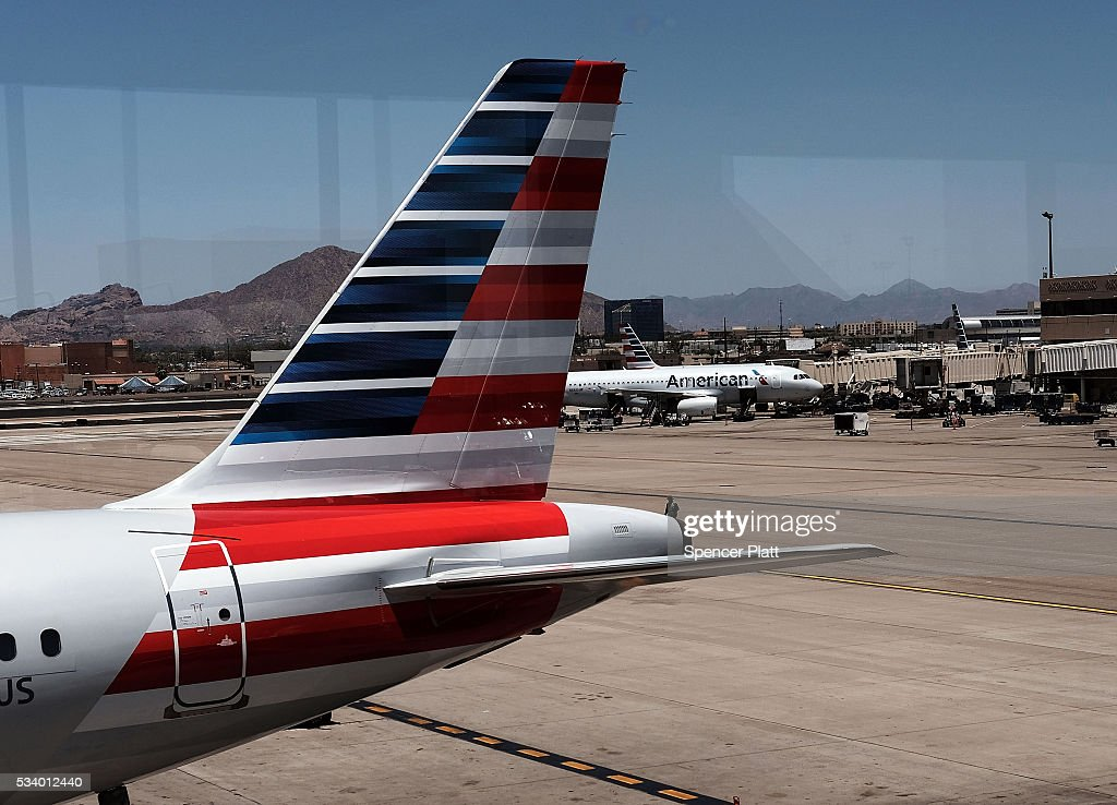 The tail of an American Airlines aircraft sits on a Phoenix runway on May 24, 2016 in New York City. The Transportation Security Administration (TSA) has come under renewed criticism from government officials and the general public following an escalation of wait times at security screenings at domestic airports as the summer travel season begins. Kelly Hoggan, the Transportation Security Administration's head of security operations, has been put on paid administrative leave pending reassignment.