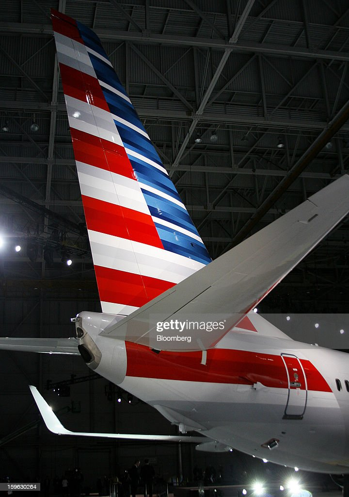 The tail of an American Airlines Inc. Boeing Co. 737-800 plane is seen during an event at Dallas-Fort Worth International Airport in Fort Worth, Texas, U.S., on Thursday, Jan. 17, 2013. American Airlines unveiled the first change in its aircraft livery in more than 40 years as it nears a decision on merging with US Airways Group Inc. or trying to leave bankruptcy on its own. Photographer: Mike Fuentes/Bloomberg via Getty Images