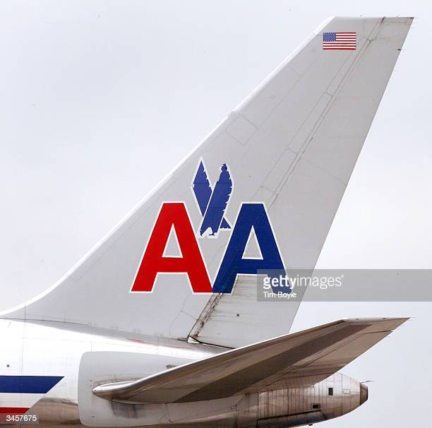The tail of an American Airlines jet is seen April 22 2004 at O'Hare International Airport in Chicago Per a government initiative American Airlines...
