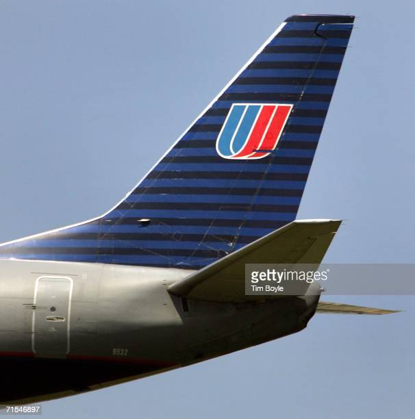The tail of an arriving United Airlines jet to O'Hare International Airport in Chicago Illinois is seen in the sky July 31 2006 over Rosemont...