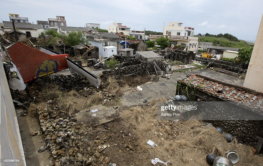 The tail of TransAsia Airways flight GE222 is seen after it fell on a local house the night before near the airport at Magong on July 24 2014 in...