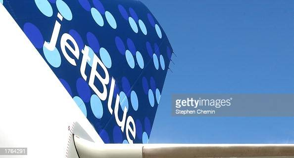 The tail section of Jet Blue's new 38th aircraft featuring the new 'PucciEsque' 1960s style graphics is shown as the aircraft is prepared for it's...