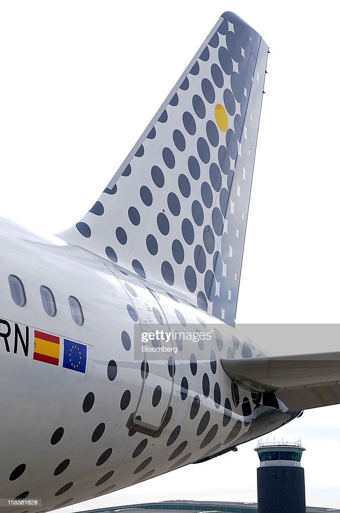 The tailfin of an Airbus A320 aircraft operated by Vueling Airlines SA is seen at EL Prat airport in Barcelona, Spain, on Wednesday, Dec. 19, 2012. International Consolidated Airlines Group SA won't require European Union approval to buy 100 percent of low-cost carrier Vueling Airlines SA, the EU's antitrust chief said. Photographer: Stefano Buonamici/Bloomberg via Getty Images