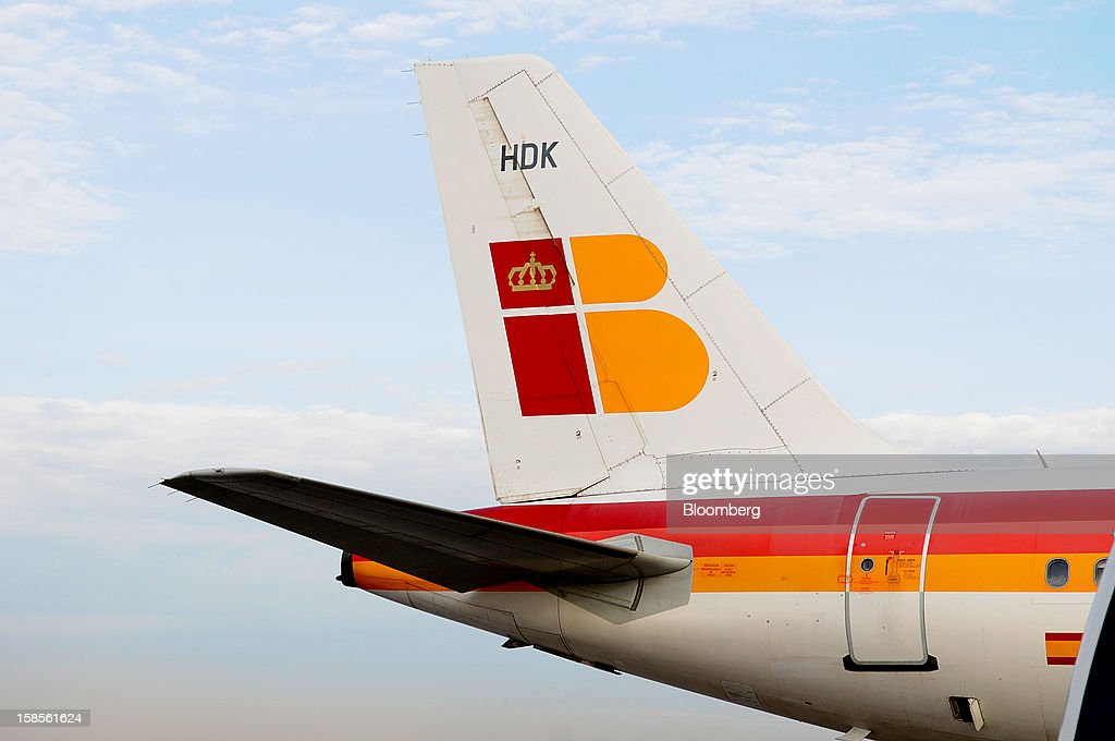 The tailfin of an Airbus A320 operated by Iberia, a unit of International Consolidated Airlines Group SA (IAG), is seen at EL Prat airport in Barcelona, Spain, on Wednesday, Dec. 19, 2012. International Consolidated Airlines Group SA won't require European Union approval to buy 100 percent of low-cost carrier Vueling Airlines SA, the EU's antitrust chief said. Photographer: Stefano Buonamici/Bloomberg via Getty Images