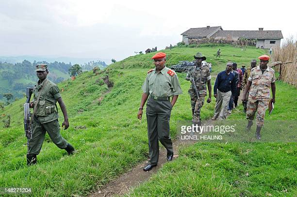 STORY 'The tainted past of DR Congo's mutinous leaders' A picture taken on January 11 2009 shows General Ntaganda Bosco walking escorted by comrades...