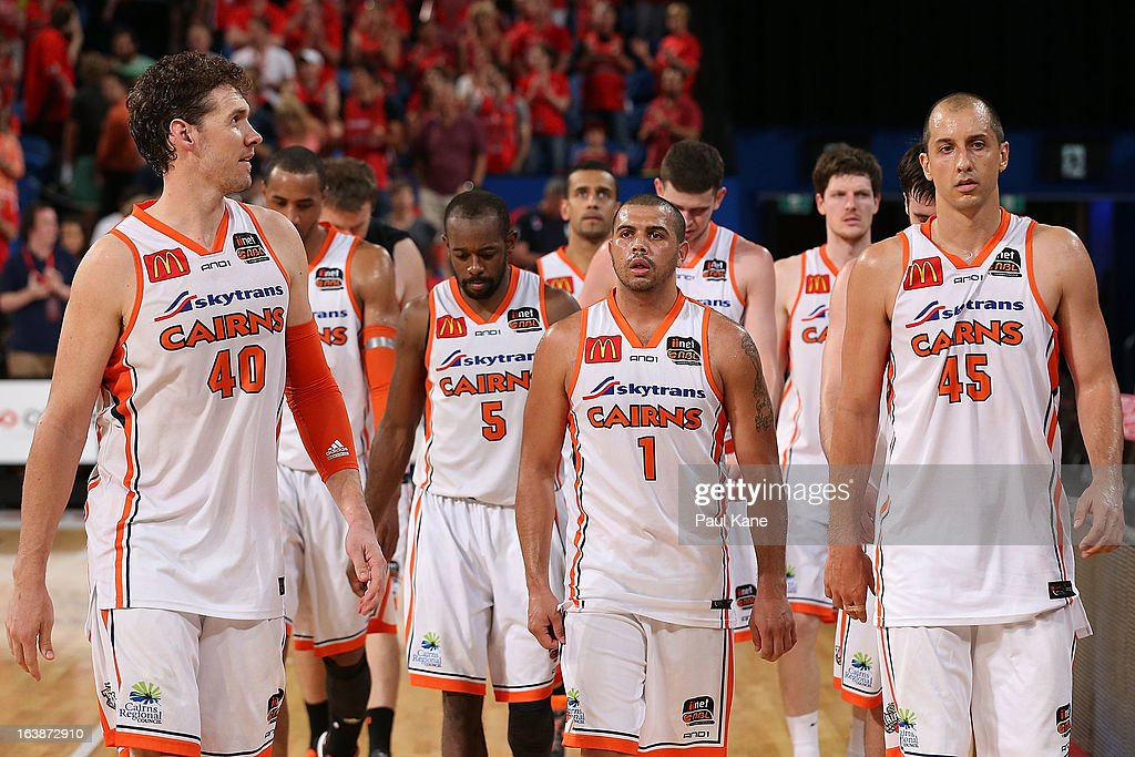 The Taipans leave the court after being defetaed during the round 23 NBL match between the Perth Wildcats and the Cairns Taipans at Perth Arena on March 17, 2013 in Perth, Australia.