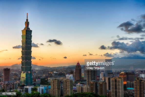 The Taipei city skyline at sunset the day before a typhoon arrives Taipei 101 formerly the tallest building in the world at 508m dominates the skyline