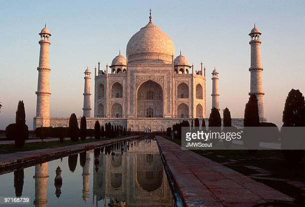 The Taj Mahal at sunrise on blue sky