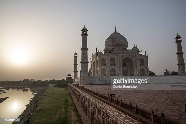 The Taj Mahal is seen from the West as the Yamuna river runs along the Northern side on May 28 2013 in Agra India Completed in 1643 the mausoleum was...