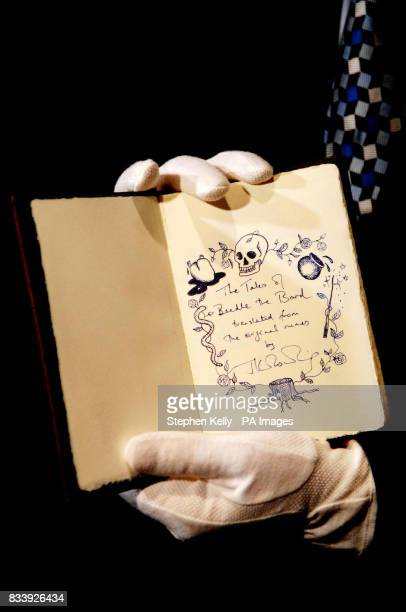 The Tales of Beedle the Bard created handwritten and illustrated by JK Rowling is displayed at Sotheby's central London today ahead of its sale on...