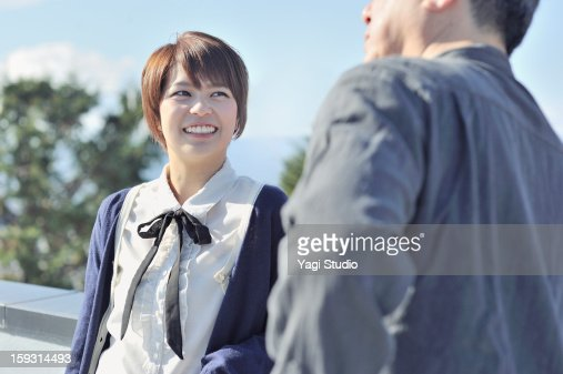 The talk in the senior men and women : Stock Photo