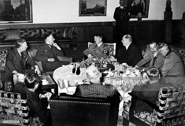 The 'talk over the teacups' at Berchesgaden on September 24 1938 L to R Joachim von Ribbentrop German Foreign Minister Neville Chamberlain Adolf...