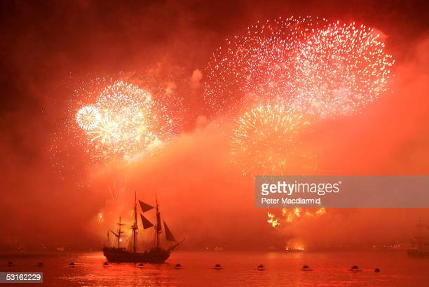 The Tall Ship Grand Turk playing the part of Admiral Nelson's flagship HMS Victory is lit up by a firework display during a reenactment of the Battle...