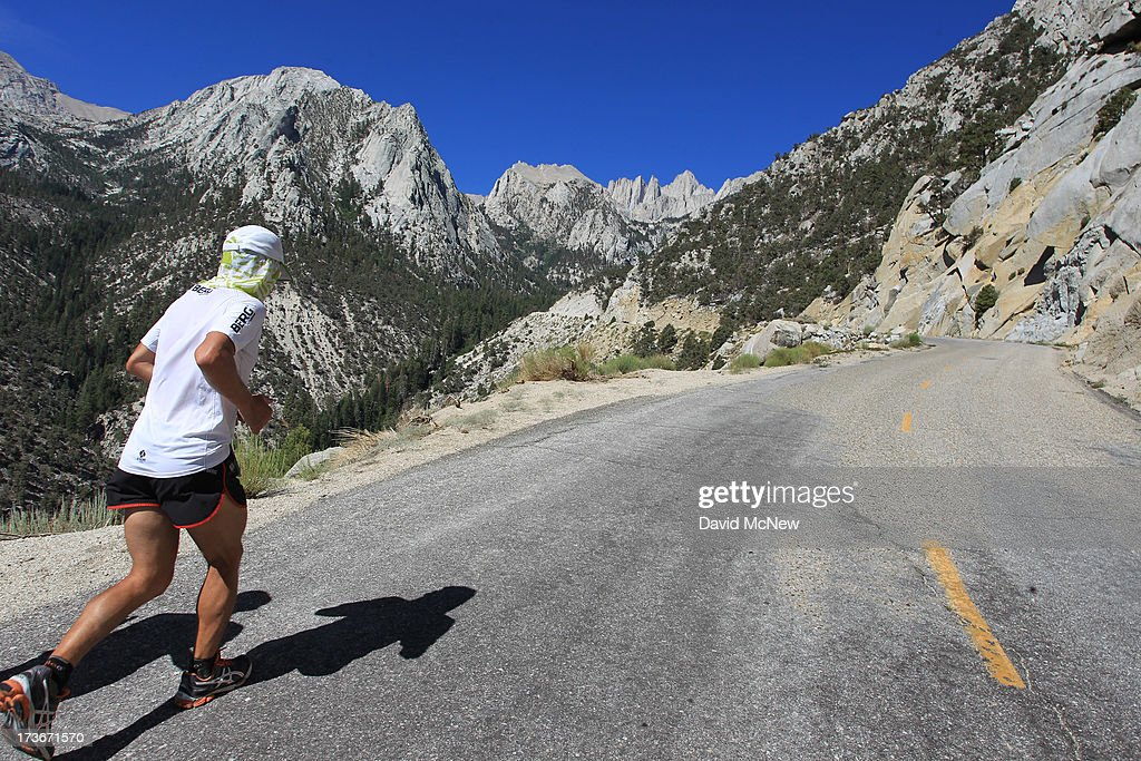 The tallest U.S. peak outside of Alaska, 14,495-foot Mount Whitney, is seen in the far distance as Carlos Alberto Gomas De Sa from Portugal, a first-time competitor in the event, runs up Whitney Portal Road on his way to win the AdventurCORPS Badwater 135 ultra-marathon race on July 16, 2013 outside of Death Valley National Park, California. Billed as the toughest footrace in the world, the 36th annual Badwater 135 starts at Badwater Basin in Death Valley, 280 feet below sea level, where athletes begin a 135-mile non-stop run over three mountain ranges in extreme mid-summer desert heat to finish at 8,350 feet above sea level near Mount Whitney for a total cumulative vertical ascent of 13,000 feet. July 10 marked the 100-year anniversary of the all-time hottest world record temperature of 134 degrees, set in Death Valley where the average high in July is 116. A total of 96 competitors from 22 nations attempted the run which equals about five back-to-back marathons. Previous winners have completed all 135 miles in less than 24 hours.
