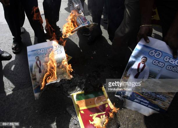 The Tamil wing of the Bharatiya Janata Party burnt pictures of Sri Lankan President Mahinda Rajapaksa who was in Mumbai to watch the ICC World Cup...