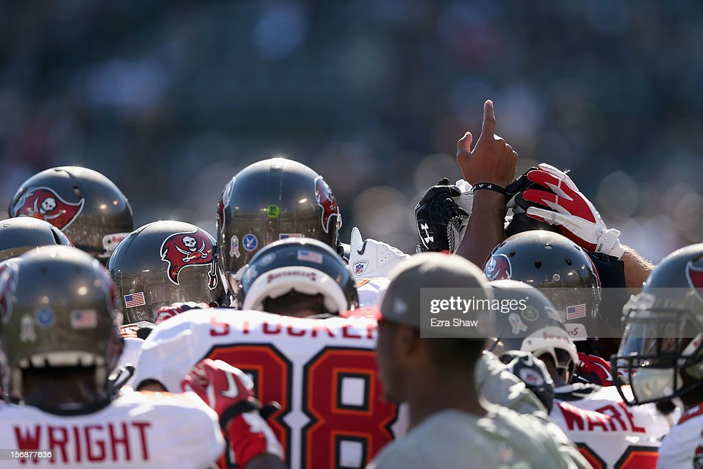 The Tampa Bay Buccaneers huddle together before their game against the Oakland Raiders at O.co Coliseum on November 4, 2012 in Oakland, California.
