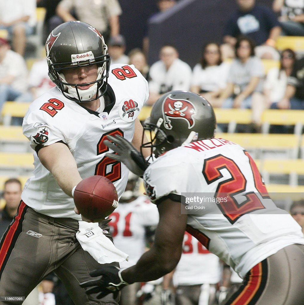 The Tampa Bay Buccaneers quarterback Chris Simms passes the ball to his teammate runningback Carnell Williams in the first half against the New...