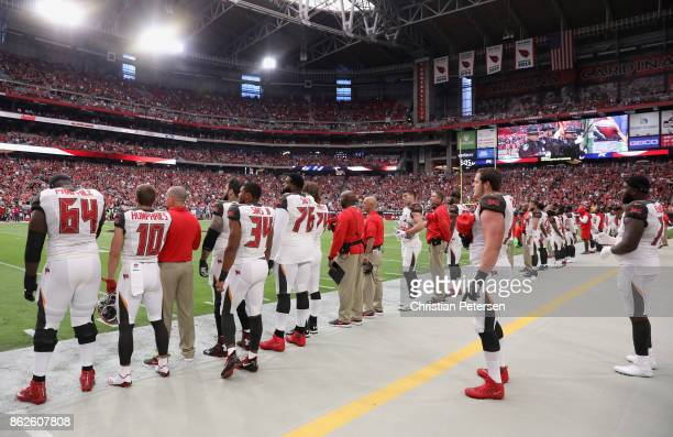 The Tampa Bay Buccaneers stand for the national anthem during the first half of the NFL game against the Arizona Cardinals at the University of...