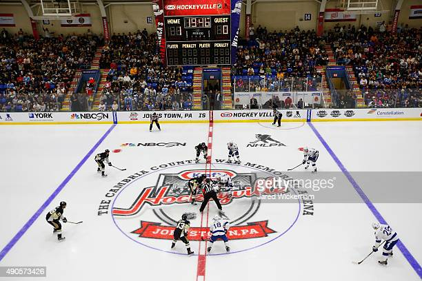 The Tampa Bay Lightning and the Pittsburgh Penguins face off in the first period of the NHL Kraft Hockeyville USA preseason game on September 29 2015...