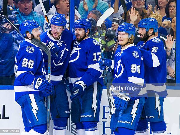 The Tampa Bay Lightning celebrate a goal by Andrej Sustr against the Pittsburgh Penguins during the first period of Game Four of the Eastern...