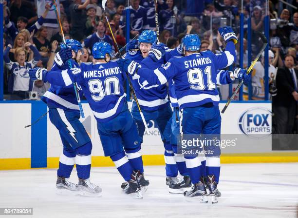 The Tampa Bay Lightning celebrate a goal by Nikita Kucherov against the Pittsburgh Penguins during the first period at Amalie Arena on October 21...