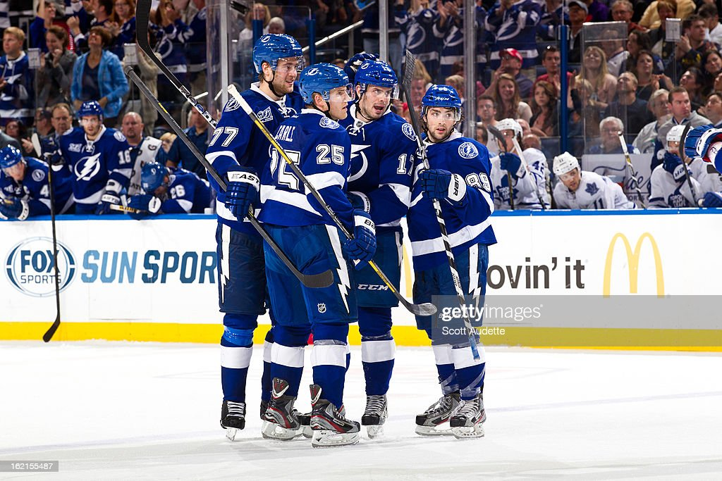 The Tampa Bay Lightning celebrate after a goal during the third period of the game against the Tampa Bay Lightning at the Tampa Bay Times Forum on February 19, 2013 in Tampa, Florida.