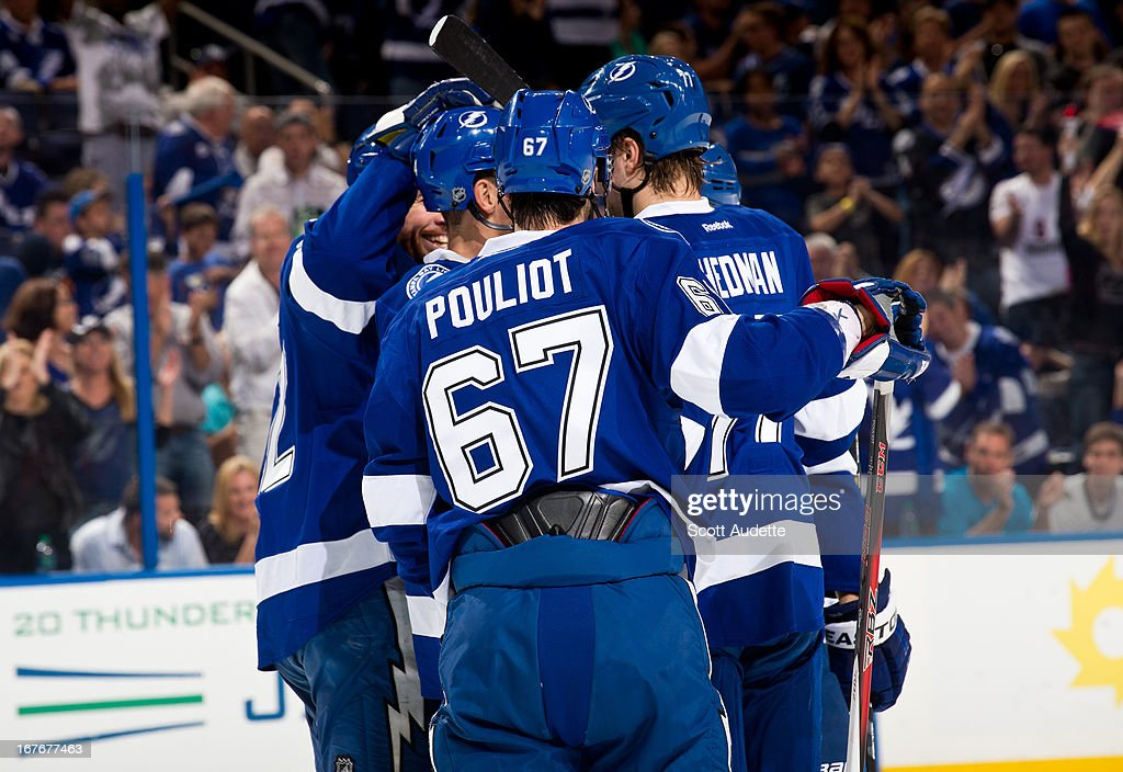 The Tampa Bay Lightning celebrate after Ryan Malone #12 of the Tampa Bay Lightning scores during the first period of the game at the Tampa Bay Times Forum on April 27, 2013 in Tampa, Florida.