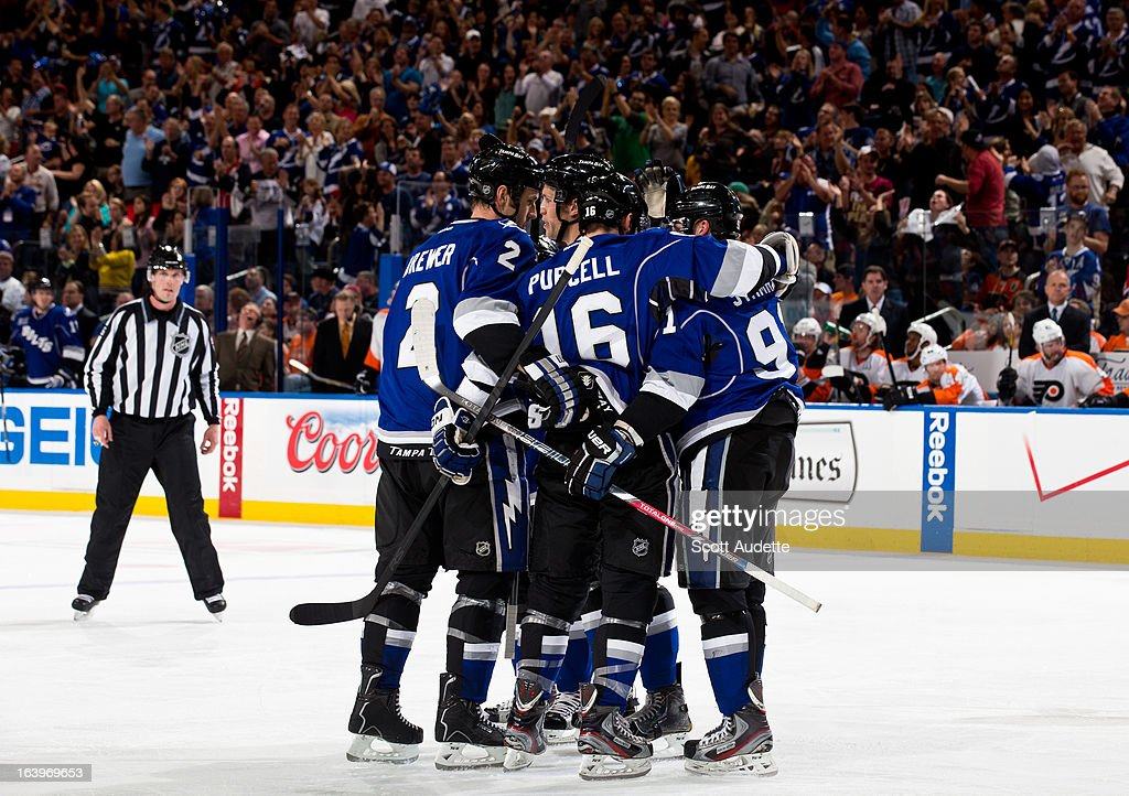 The Tampa Bay Lightning celebrate after <a gi-track='captionPersonalityLinkClicked' href=/galleries/search?phrase=Teddy+Purcell&family=editorial&specificpeople=4537302 ng-click='$event.stopPropagation()'>Teddy Purcell</a> #16 of the Tampa Bay Lightning scores during the third period of the game against the Philadelphia Flyers at the Tampa Bay Times Forum on March 18, 2013 in Tampa, Florida.