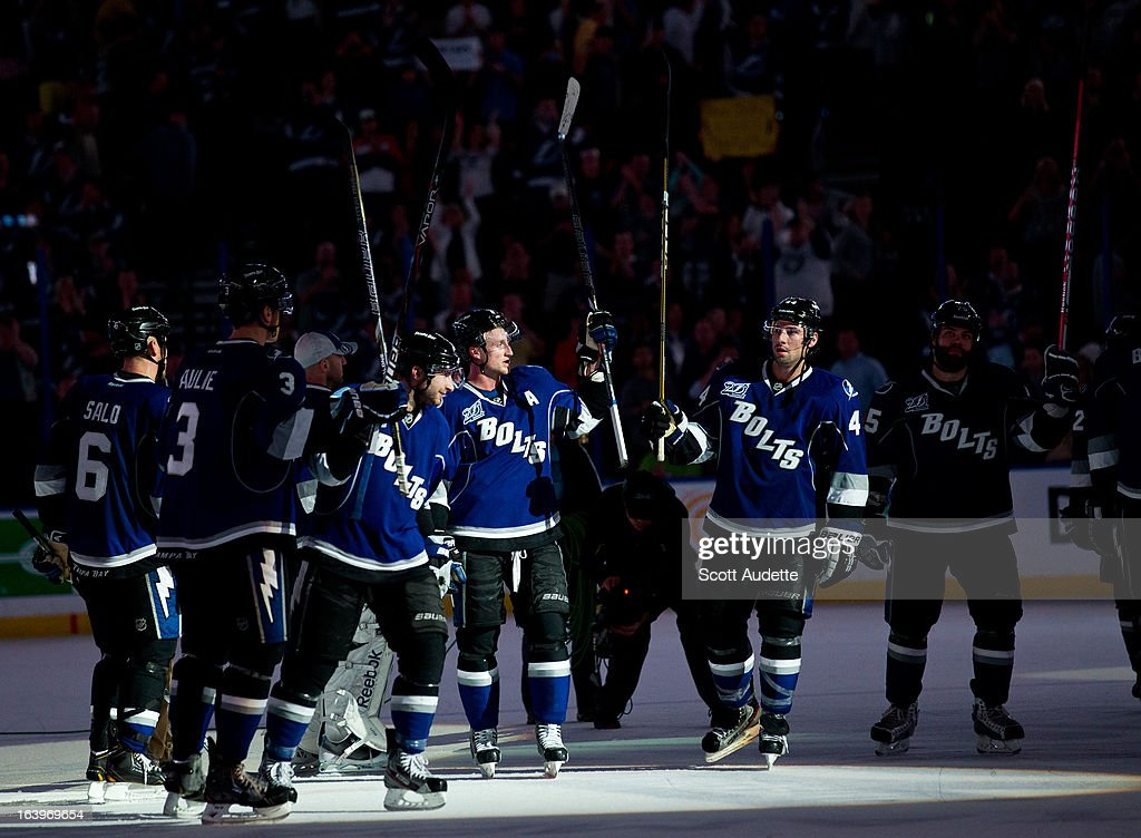 The Tampa Bay Lightning celebrate after their second consecutive home victory and defeating the Philadelphia Flyers 4-2 at the Tampa Bay Times Forum on March 18, 2013 in Tampa, Florida.