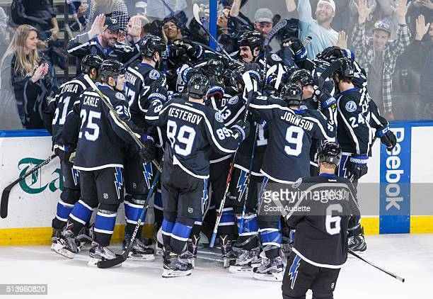The Tampa Bay Lightning celebrate the win against the Carolina Hurricanes after setting a franchise record nine wins in a row after the game at the...
