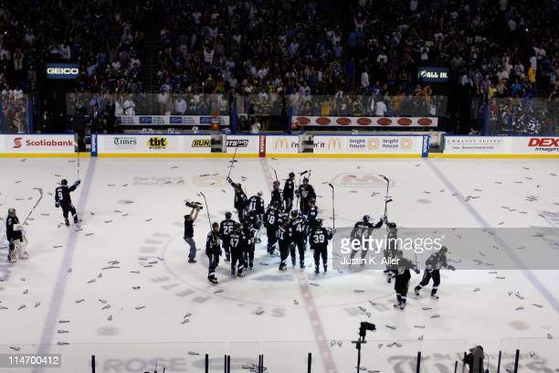 The Tampa Bay Lightning celebrate their 5 to 4 win over the Boston Bruins in Game Six of the Eastern Conference Finals against the Boston Bruins...