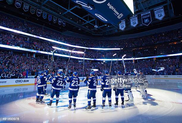 The Tampa Bay Lightning salute fans after being introduced before the game against the Philadelphia Flyers at the Amalie Arena on October 8 2015 in...